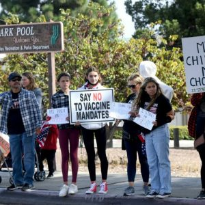Unvaccinated Americans protest mandates as the pace of new vaccinations slows